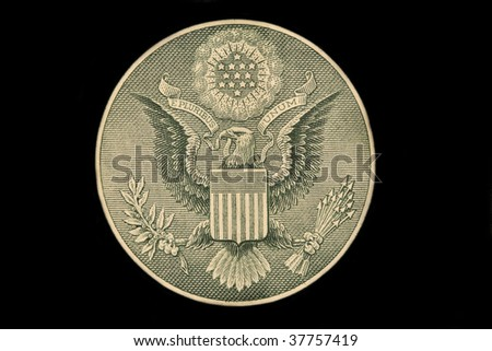 The US dollar bill great seal isolated on black - stock photo