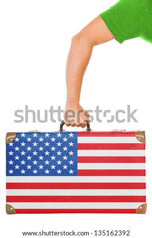 The USA flag on a suitcase. Isolated on white.