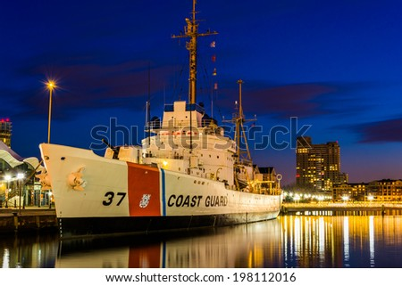 The USGC Taney Coast Guard Cutter at night, in the Inner Harbor of Baltimore, Maryland. - stock photo