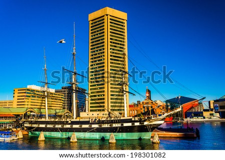 The USS Constellation and World Trade Center, in the Inner Harbor of Baltimore, Maryland. - stock photo