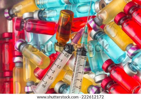 the vaccine and a hypodermic syringe must use a pair - stock photo