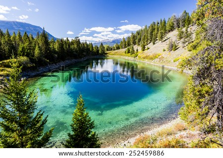 The Valley of the Five Lakes hike offers clear lakes with unique shades of jade and blue. The Valley of the Five Lakes loop is just under a 5km circuit. - stock photo
