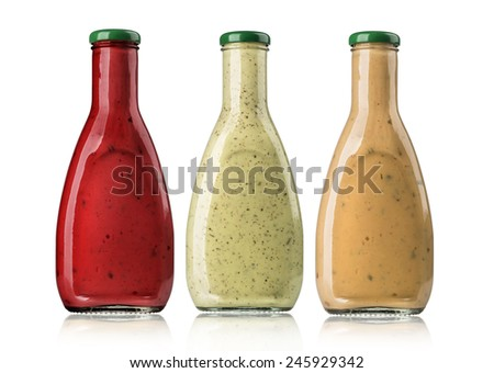 the various barbecue sauces in glass bottles with clipping path - stock photo