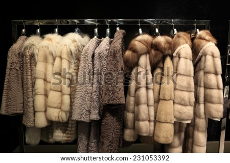 The various fur coats at the store - stock photo