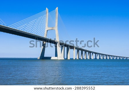 The Vasco da Gama Bridge in Lisbon, Portugal. It is the longest bridge in Europe - stock photo