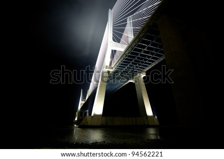 The Vasco da Gama Bridge is a famous sight in Lisbon / Portugal - stock photo
