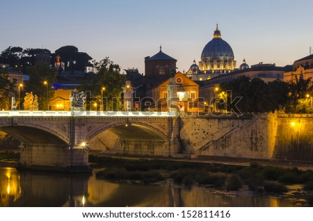 The Vatican in Rome, Italy at dusk. With The river Tiber, Tevere, in the foreground