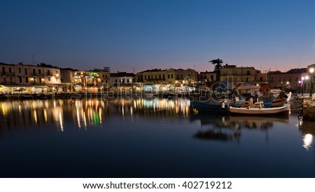 The venetian harbor of Retymno with lots of restaurants at the pier. - stock photo
