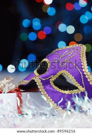 The Venetian mask on a abstract  background - stock photo