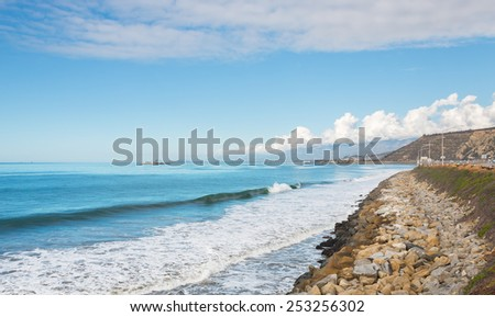 The Ventura county, California coastline just south of Mussel Shoals and La Conchita.  Rincon Island can be seen in the distant background. - stock photo