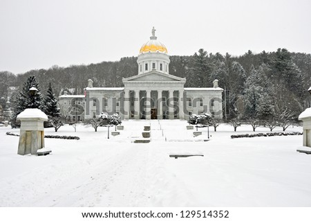 The Vermont Statehouse in February, surrounded by snow. - stock photo