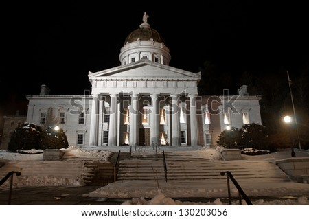 The Vermont Statehouse is well lit on a winter night. - stock photo