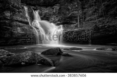 The very beautiful Cedar Falls  in Hocking Hills Ohio in black and white. Very popular tourist attraction. - stock photo