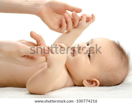 the very  beautiful  little baby with hands mother  , close face,  on white background, isolated - stock photo