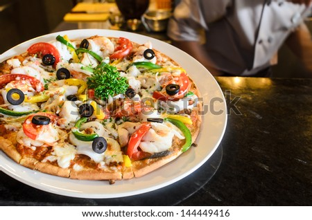 the very italian pizza coming out of a wood burning pizza oven - stock photo