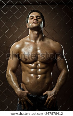 the very muscular handsome sexy guy on black background, naked  torso - stock photo