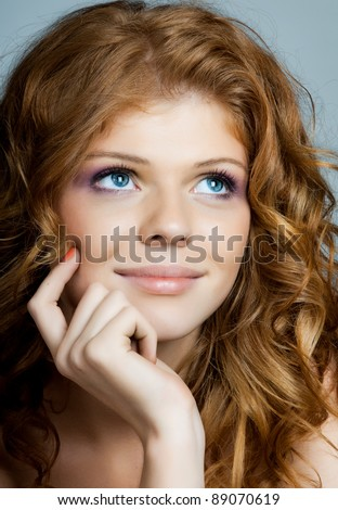 the very  pretty red-haired freckled young  dreamy woman  , vertical portrait closeup