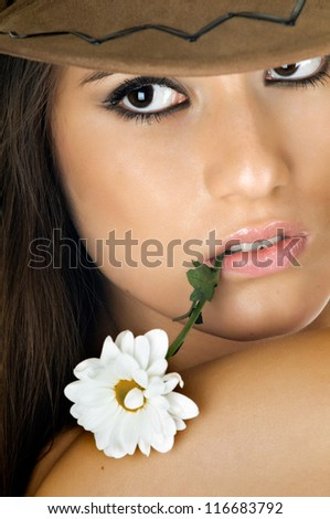 the very  pretty woman  closeup portrait, on white background in cowboy-hat, with camomile, sensual sexuality gaze, isolated