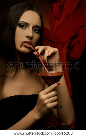 the very  pretty woman vamp, with glass and blood , sensual sexuality gaze...