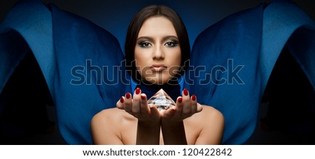 the very  pretty woman with blue neckerchief,  with huge brilliant - stock photo
