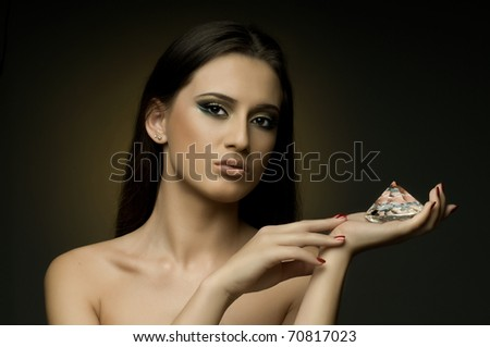 the very  pretty young woman with dark brown neckerchief,  with huge brilliant, sensual sexuality gaze... - stock photo