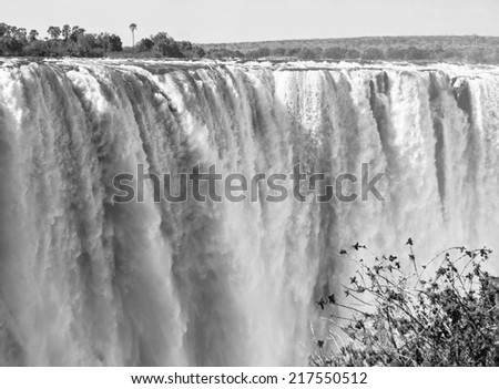 The Victoria falls is the largest curtain of water in the world  (1708 m wide). The falls and the surrounding area is the National Parks and World Heritage Site - Zambia, Zimbabwe (black and white) - stock photo