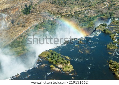 The Victoria falls is the largest curtain of water in the world (1708 m wide). The falls and the surrounding area is the National Parks and World Heritage Site (helicopter view) - Zambia, Zimbabwe