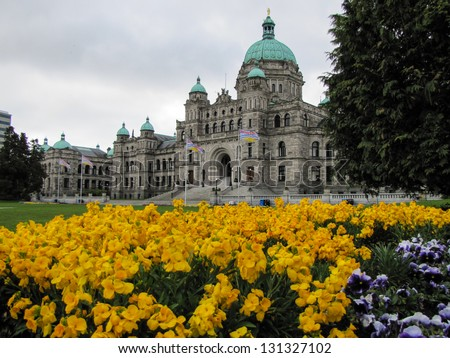 The Victoria Provincial Parliament Building with flowers at harbor in province of British Columbia Canada - stock photo