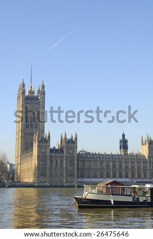 The Victoria Tower at the Houses of Parliament in London, England - stock photo
