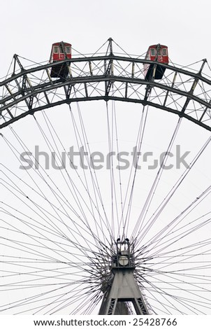 the viennese giant wheel is a ferris wheel in the famous austrian amusement park prater. it is about 60 meters high and was designed by walter basset - stock photo