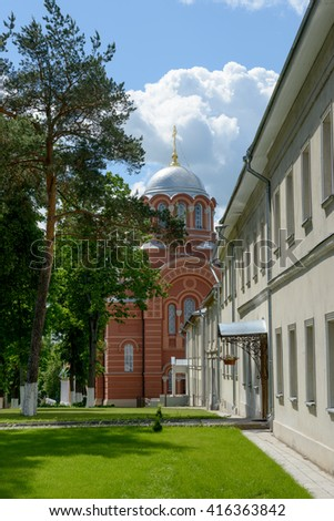 The view along central alley from northern side towards St Nicholas Cathedrals of Intercession (Pokrovsky) Khotkovo Monastery, Moscow Region, Russia.