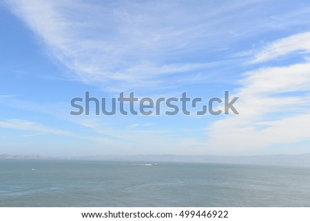The  view and scenery of island, sea in faraway with beautiful clear blue sky on sunny day. Landscape and Seascape with copy spaces