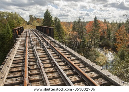 The view from an abandoned railway bridge in autumn. Nova Scotia, Canada. - stock photo