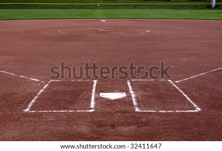 The view from behind the plate on a vacant softball field. - stock photo