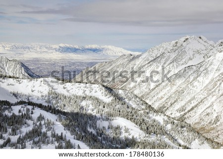 The view from the top of Snowbird Ski Resort, in Utah looking down across the valley to Salt Lake City in winter. - stock photo