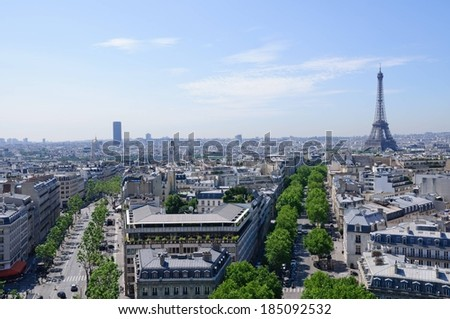 The view from the top of the Arc de Triomphe down, at left, the Avenue Marceau towards the Montparnasse Tower, and down the Avenue d'Iena towards the Eiffel Tower, Paris. - stock photo