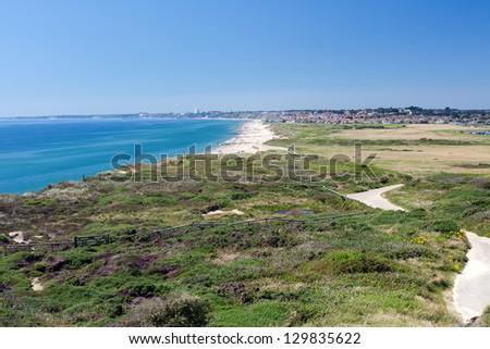 The view from Warren Hill on Hengistbury Head towards Bournemouth and Sandbanks. - stock photo