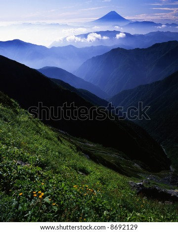 The view Mt,Fuji from far Japanese South Alps in summer - stock photo