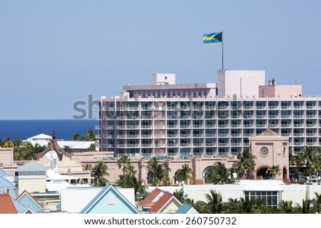 The view of a resort building with a flag of The Bahamas on Paradise Island. - stock photo