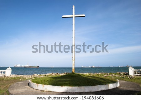 The view of a rusty cross in Colon city - the gateway to Panama Canal. - stock photo