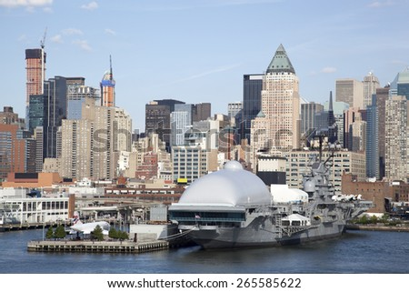 The view of historic military ship with Manhattan skyline in a background (New York City). - stock photo