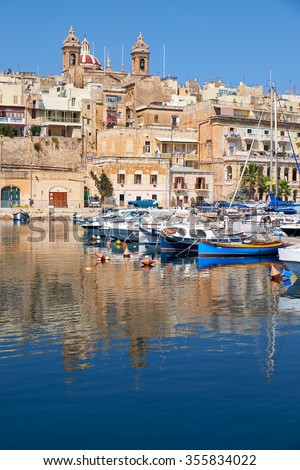 The view of historical buildings of Senglea over the Dockyard creek. Malta.