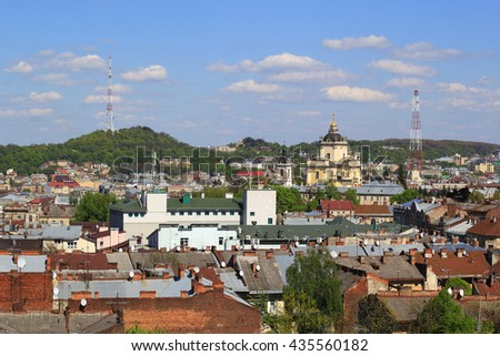 the view of Lviv roofs and the city and Saint George Cathedral in the distance