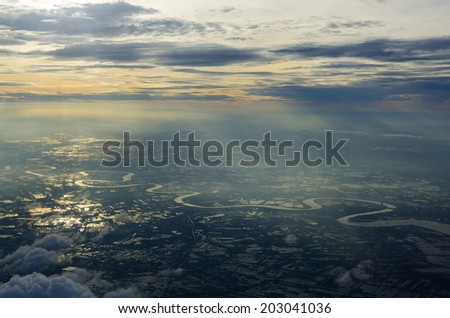 The view of mountains from the plane. - stock photo