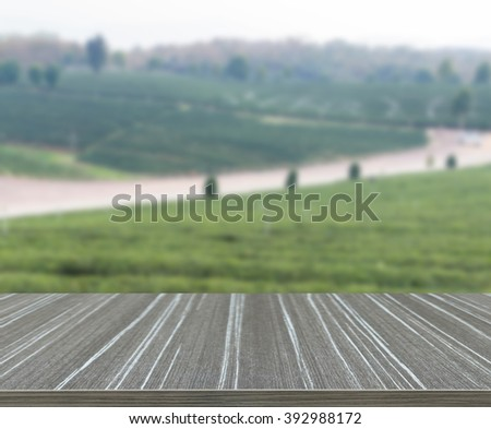 the view of oolong tea farm in rural thailand (blur background and wooden table for displaying your product)