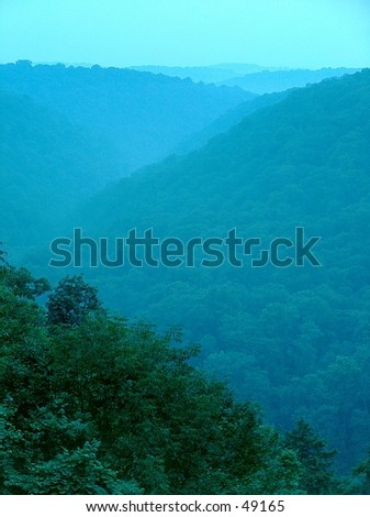 The view of Slippery Rock Gorge from Cleland Rock in McConnell's Mill State Park, Pennsylvania during the misty late summer. - stock photo