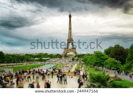 The view of the Eiffel Tower and the Trocadero Gardens in Paris, France. Paris is one of the most popular tourist destinations in Europe. - stock photo