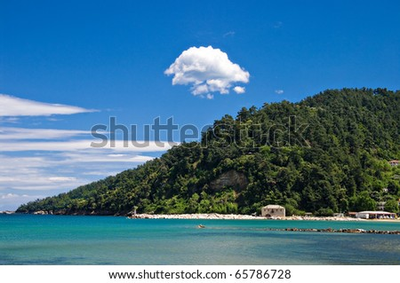 the view of the headland from a beach-side taverna on thassos, greece - stock photo