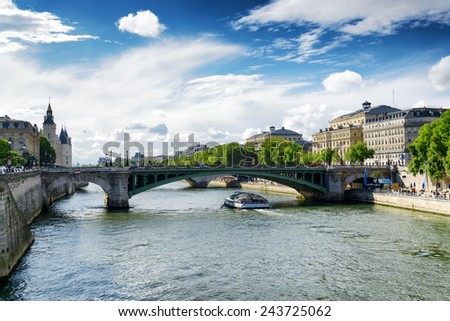 The view of the Notre Dame Bridge over the River Seine in Paris, France. Paris is one of the most popular tourist destinations in Europe. - stock photo