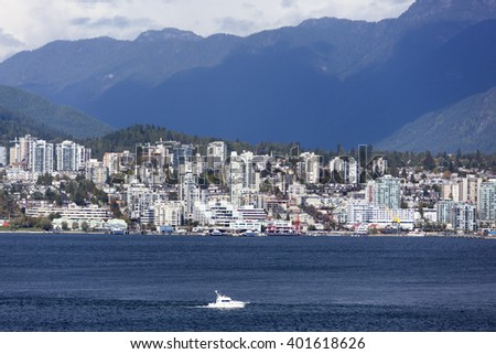 The view of West Vancouver with a boat passing by (British Columbia, Canada). - stock photo